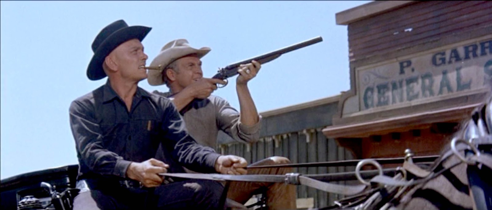 Chris yul brynner and vin steve mcqueen ride to boot hill
